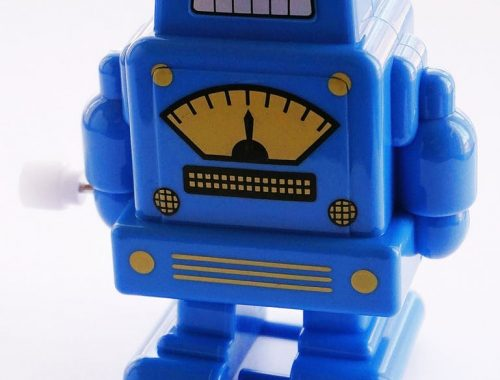 blue and yellow robot toy